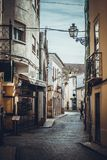 Narrow streets in the city of Tomar. Walk through the narrow and ancient streets in the city of Tomar, Portugal stock photography