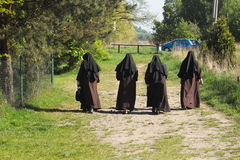 Walk nuns. Nuns walk in the spring of 2015 royalty free stock photography
