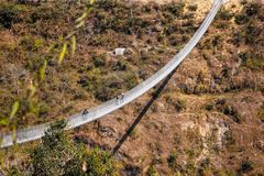Walk over the bridge. One of the newest and longest suspension bridges in Pokhara. This spans across the Seti River royalty free stock photography