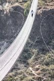Walk over the bridge. One of the newest and longest suspension bridges in Pokhara. This spans across the Seti River royalty free stock photo