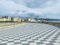 A walk over the sea. Mascagni terrace in Livorno, with its chess texture Stock Image