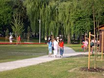 Walk in park. People walking in summertime royalty free stock photography