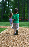A walk in the park. Two children taking a walk in the park Stock Image