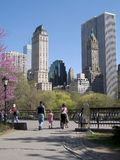 Walk In The Park. A family strolls through Central Park during Spring time in New York Royalty Free Stock Photo