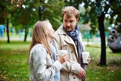 Walk in park. Affectionate dates with drinks taking walk in park Stock Photos