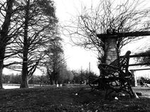A walk in the park. Black and white with oil painting effect Royalty Free Stock Photography