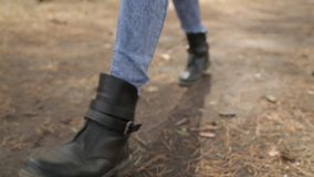 Walk in the park and legs in the frame. Footsteps on the ground in the woods stock video