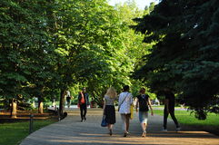 Walk in the park. People passing by the path summer evening in Museon Park in Moscow Royalty Free Stock Photography