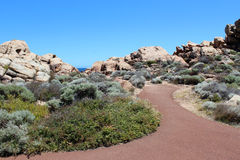 Walk path at Canal Rocks Western Australia in summer. The beautiful   walk path landscape at  Canal Rocks south west Australia displays the iconic rock Stock Photo