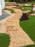 Walk path in garden. Park decorated with stone Stock Images
