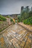 Walk path by Monteriggioni city wall. Tuscany, Italy Royalty Free Stock Images