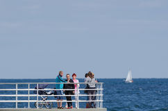 WALK ON THE PIER. KOLOBRZEG, WEST POMERANIAN / POLAND: Holidaymakers walk the pier Stock Image