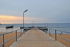A walk on the pier. The pier leading to the water on lake Niassa in Mozambique stock photo