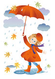 Walk in the rain. A girl with a red umbrella goes for a walk in the rain Royalty Free Stock Photography