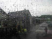 Walk in the rain of person near roadside cafe. Blurred stock photo