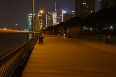 Walk by the river in Shanghai, with skyscrapers. Royalty Free Stock Photos