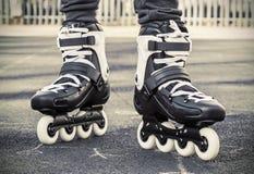 Walk on roller skates for skating. toned photo. Walk on roller skates for skating. Focus on roller skates. toned photo Stock Photo