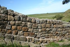 Walk the Roman Wall. Roman wall streches from coast to coast and is 73 miles long. You are not allowed to walk on the wall but there are beautiful paths along stock photos