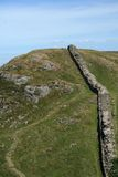 Walk the Roman Wall. In beautiful Northumberland the Roman Wall pass through many different types of country, this is hilly rough country where you can walk stock photography