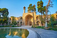 Walk in garden of Sepahsalar mosque, Tehran. The walk in scenic garden of Sepahsalar Shahid Motahari mosque with shady alley, scenic pond and many benches to royalty free stock photos