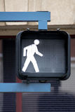 Walk Sign. Black Sign Held by Blue Supports Lights Up in the Shape of a Man Walking Signaling that its OK to Walk Across the Street Stock Photos