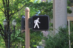 Walk sign for pedestrians crossing the road Royalty Free Stock Photos