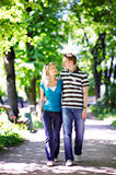 Walk in spring park. Man and woman. Happy lovers on romantic walk Stock Photos