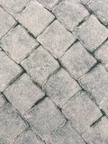 Walk street pattern. Old cobblestone and lichen are between gap royalty free stock photos