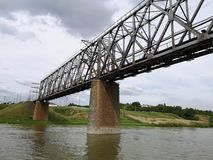 Walk in the summer on a boat on the river under the bridge. Railway bridge in Pavlodar in summer, railway bridge in Kazakhstan, boat trip on the river under the stock photography