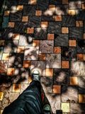 Walk on tiles royalty free stock photography