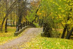 Walk to the bridge. The bridge in park autumn in the heat, the middle of day Stock Image