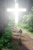 Walk to the Cross. Man walking to a Christian Cross of light stock image