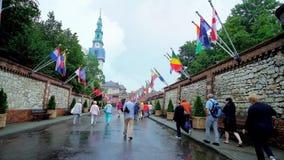 Walk to the gate of Jasna Gora Monastery, Czestochowa, Poland. CZESTOCHOWA, POLAND - JUNE 12, 2018: The tourists walk Podjasnogorska street to the Totus Tuus stock footage