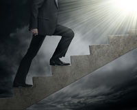 Walk to the light. A businessman walk up to search the new opportunity Royalty Free Stock Photo