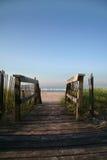 Walk to Serenity. Boardwalk leading to beautiful ocean beach stock photography