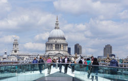 Walk to st paul. A picture of people walking in a bridge to st paul church in London,near the thames river,in a summer day Royalty Free Stock Image