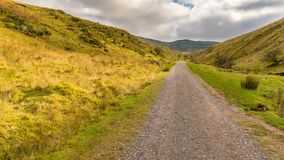 Walk towards Llyn y Fan Fach, Wales, UK. Landscape in the Brecon Beacons National Park on the way to Llyn y Fan Fach in Carmarthenshire, Dyfed, Wales, UK Stock Photos