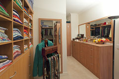 Walk in wardrobe. Luxury walk in wardrobe with clothes and jewellery Stock Photography
