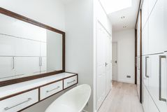 Walk in wardrobe and dressing room in white Stock Images