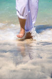 A walk through the waves Stock Image