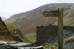 Walk this Way. Public Bridlepath sign leading to mountain top near a slat mine in the stunning Lake District, England royalty free stock photography