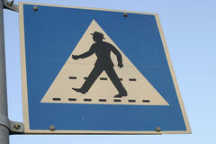 Walk this way!. Pedestrians crossing sign. shallow DOF moving from the bottom up royalty free stock photography