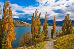 Walk way near Lakes Hayes. Crown Range mountains behind the lake. , New Zealand Royalty Free Stock Photo