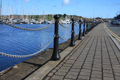 The walk way next to the sea. Near by the boat yard in Ireland Stock Image