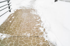 Walk way in the park cover with snow in winter time . Stock Photos