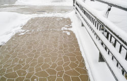 Walk way in the park cover with snow in winter time . Royalty Free Stock Image