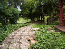Walk way in the park. Stone side walk in the park stock photos