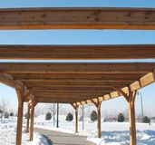 Walk way pergloa. Pergola on the pathway in a park in the winter royalty free stock images