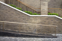 Walk way and staircase with brick wall background Stock Photos