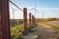 Walk way to power generation wind turbine Stock Photo